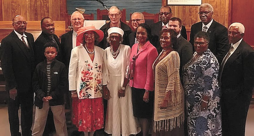 The speakers, church members, and descendants of the first pastor.