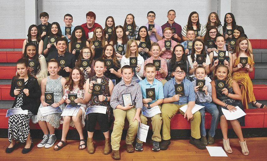 Top ten students in each class (L to R): Front Row, Fifth Grade — Kaelyn Stebbins, Morgan Little, Molly French, Katelynn Essary, Coleson Cook, Tobey Brooks, Dylan Bomar, Brody Berryhill and Gracie Aird; Second Row, Sixth Grade — Jaylin Taylor-Megaw, Tate Surber, Emma Smith, Lydia Pate, Hannah Lee, Carter Kee, Allyson Gibson, Jada Flippin, Rachel Essary and Briley Arnold; Third Row, Seventh Grade — Abbie Young, Ava Warman, Jackelyne Padilla, Allie Mansfield, Isabella Etter, Skyelor DeLoach, Chandler Conrad, Jake Cassidy, Sarah Boackle and Bella Arnold; Back Row, Eighth Grade — Austin Bush, Nathan Price, Daniel Latimer, Lauren Laser, Allie Laser, Andrew Harvey, Jackson Cassidy, Kassidy Brown, Kristin Bradberry and Briley Auvenshine. Not pictured is Landyn McLearen, fifth grade.