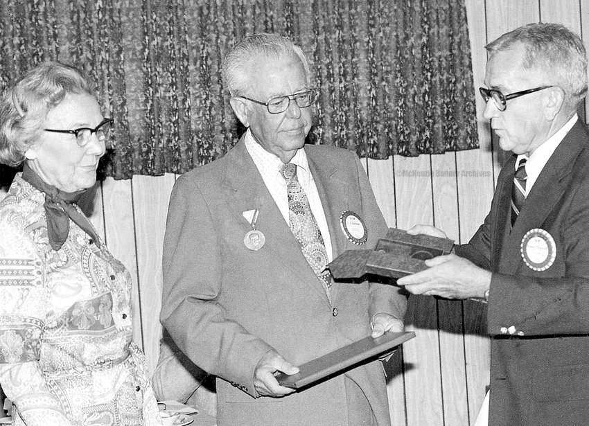 Dr. J. A. Barksdale receives the Paul Harris Fellowship award from the McKenzie Rotary Club, as wife, Eleanor looks on, 1977.