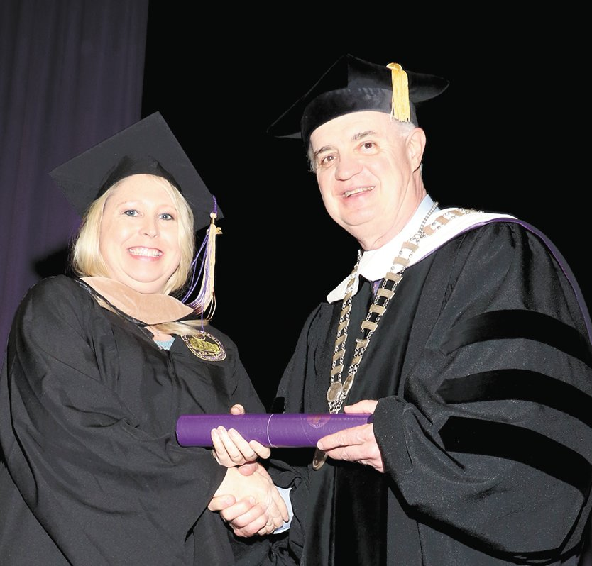 April Chance receives her masters degree.