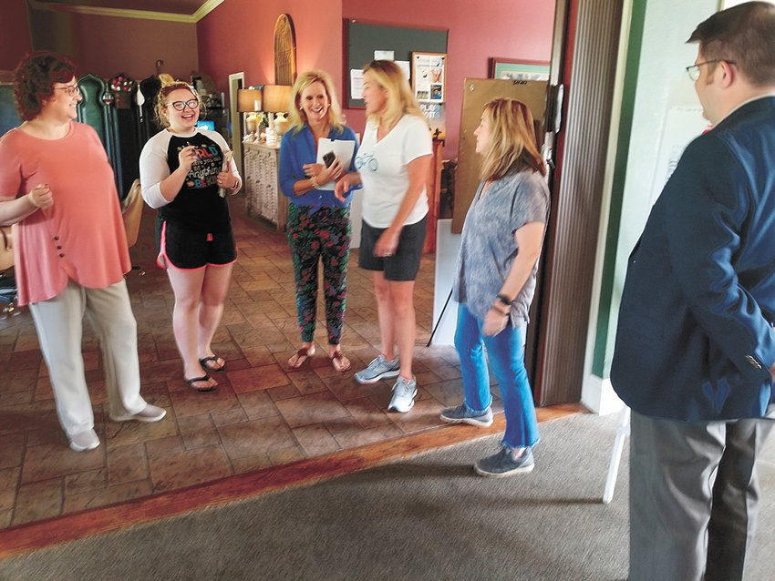 Pictured are members of the Paris and Healthcare Foundation Spring Fundraiser committee along with staff from KPAC discussing plans for the upcoming Murder Mystery Cocktail Fundraiser on Saturday, May 11 at Paris Country Club.  Tickets are $25 and available at Maggie's, Paris Country Club, the Iron Place, HCMC, and Bo & Co.