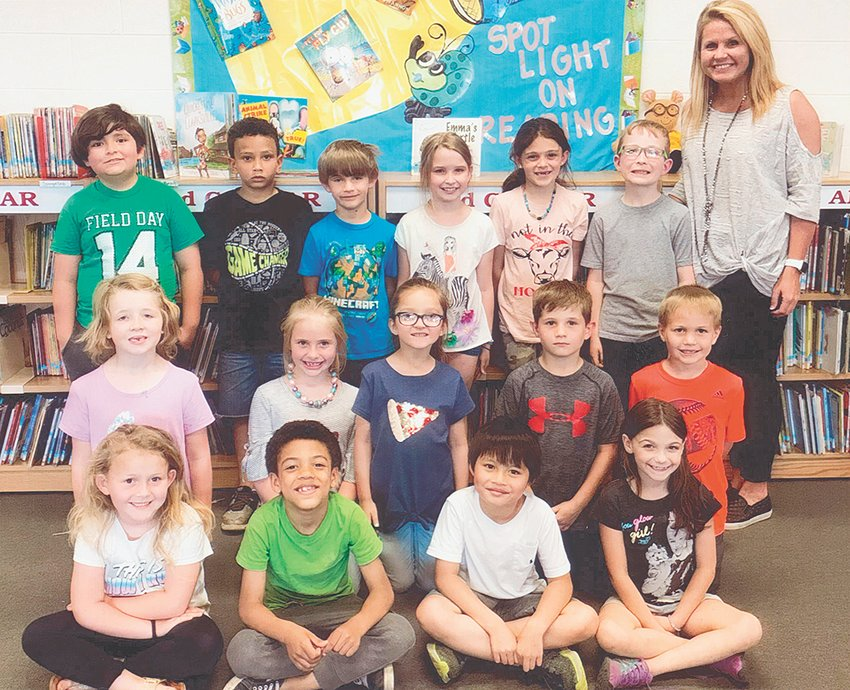 Ms. Anna Trull's first grade class reached its reading goal of 1,000 Accelerated Reader points in May. The class maintained an average of 94.9 percent correct in comprehension while achieving the goal. Congratulations to the class and keep up the hard work!
