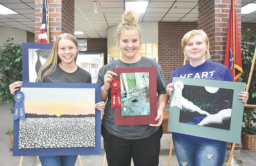 "McKenzie High School art winners (L to R): First Place — Ashlyn Drewry, ""Snow of the South"" in acrylic on canvas; Second Place — Sarah Jackson, ""It's All Fun and Games..."" photograph; Third Place — T.J. Barker, ""Alaskan Night"" in acrylic on canvas."