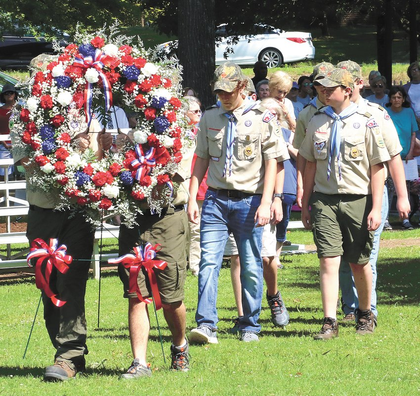 Boy Scout Troop 73 places the wreath at the war memorial in Huntingdon.