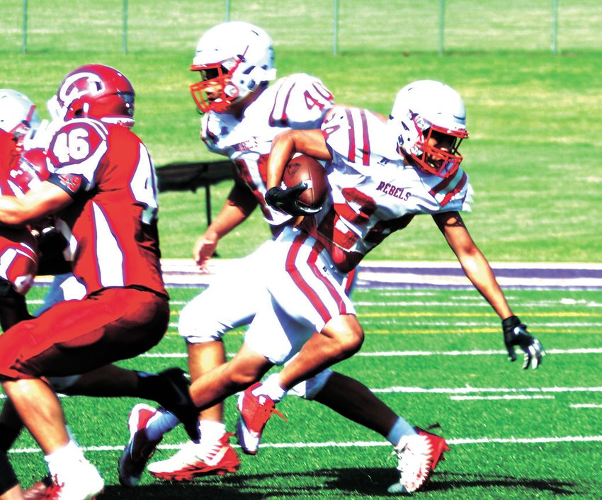 Micah Austin (24) carries for the Rebels against Crockett County in the annual spring scrimmage wrapping up spring football practice May 16.
