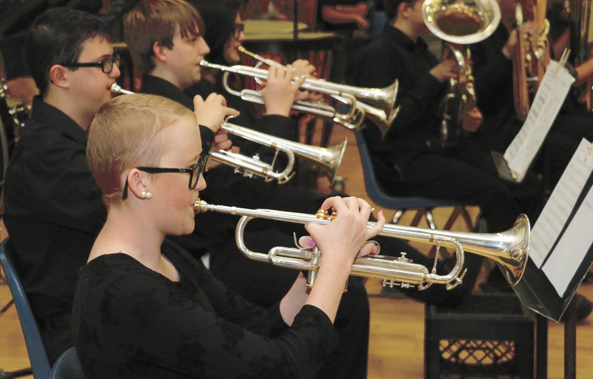 Hannah Reeves plays a trumpet with the HHS Band during graduation.