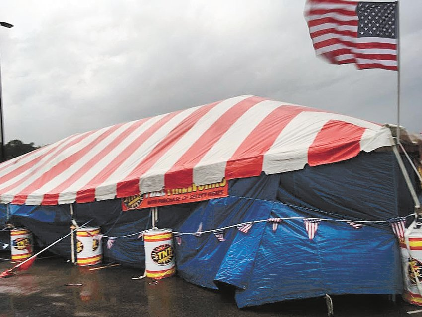 The large fireworks tent sustained bent support poles and shifted about two feet during the high winds Friday evening. Some fireworks were blown from their display shelves onto the wet ground.