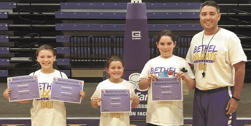 (L to R) Kaitlyn Patterson, Aubrey Hammett, Paislee Wall, and Bethel Coach Chris Nelson.