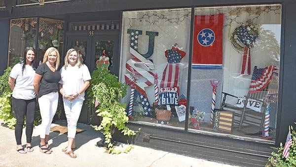 """Morning Glory Garden Presents  Club 'Patriotic' Business Award  McKENZIE — The Morning Glory Garden Club has selected Belles on Broadway for the """"Most Patriotic Window"""" award.  The shop has been exquisitely renovated inside and out by owner Tessa O'Brien, and the windows feature a large variety of American flags and gorgeous decorative patriotic motif items. Tessa, many thanks to you and your lovely staff for making our downtown a more beautiful place and for your wonderful expression of patriotism in our community. Pictured are (L to R): Emily France, manager; O'Brien; and Stacie Browning, designer."""