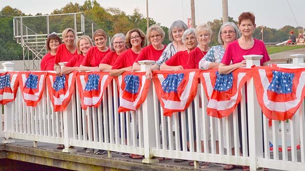 The ladies service organization Beta Sigma Phi added just the right festive touch to the pier at McKenzie's Recreational Park for the much-anticipated Freedom Festival fireworks extravaganza celebrating our country's birthday. Pictured are (L to R): Fay Garrett, Amanda Lifsey, Karen Fowler, Sandra Spires, Jennifer Waldrup, Debbie Broadbent, Brenda Berryman, Susan Nelson, Nellie Hale, Bonnie Dillon, Lisa Fortner and Janet Baumgardner. Not pictured are Gail Robb, Karen McCaleb and Peggy Hutchison.