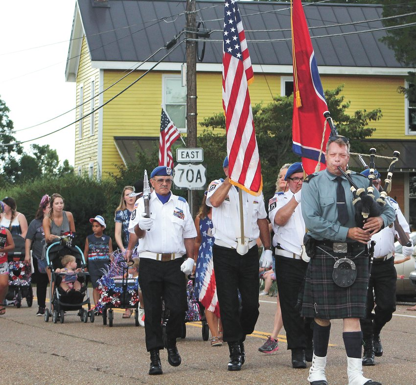 Dennis Dudley (bagpipes) along with other members of the Veterans Honor Guard of Parkers Crossroads presenting the colors.