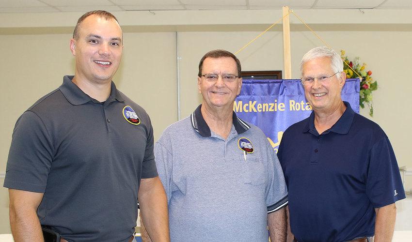 Ryan Drewry and Danny Brawner of Carroll County Electric along with Rotarian Terry Howell, who serves as the chair of the board for CCED.