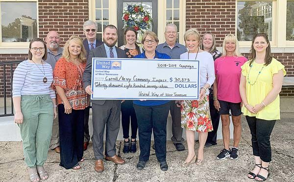 From left (holding check), Mayor Joseph Butler, United Way of West Tennessee Board Member; Roberta Fuller, Dana Inc. Campaign Coordinator; and Mayor Jill Holland, City of McKenzie, present a check on behalf of United Way of West Tennessee to representatives of Carroll and Henry County agencies.