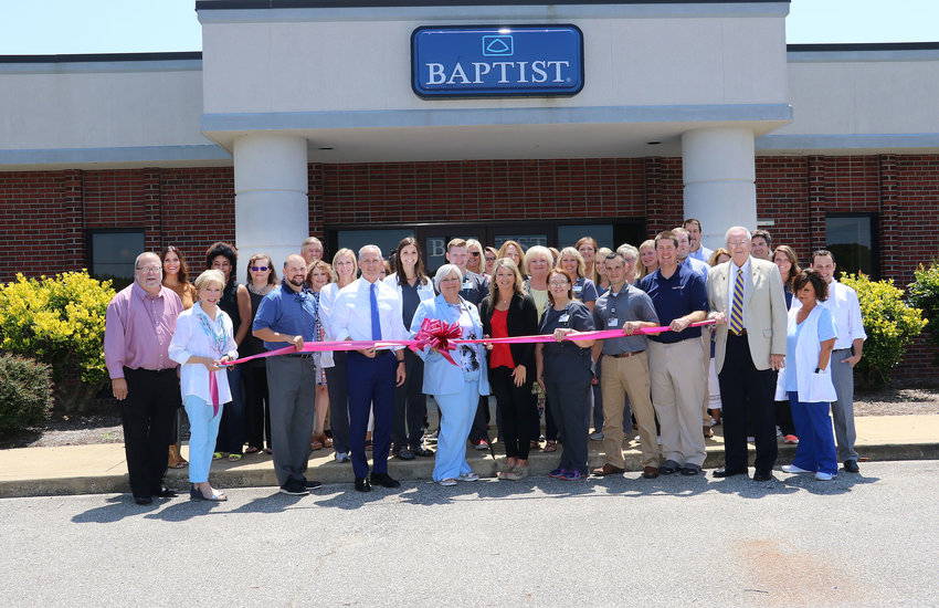 Julie Bartholomew cuts the ribbon to the recently-opened Baptist Rehabilitation in McKenzie.