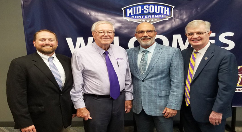 Bethel Associate AD Brad Chappell, AD Dale Kelley, MSC Commissioner Eric Ward and Bethel President Walter Butler.