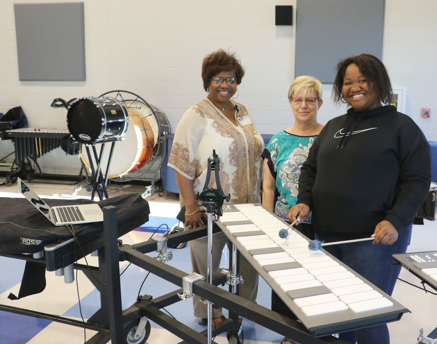 Emily Taylor, a HHS senior band member, demonstrates the new electronic MalletStation to her mom, Nicole, and friend, Ruth Ann Rhodes.