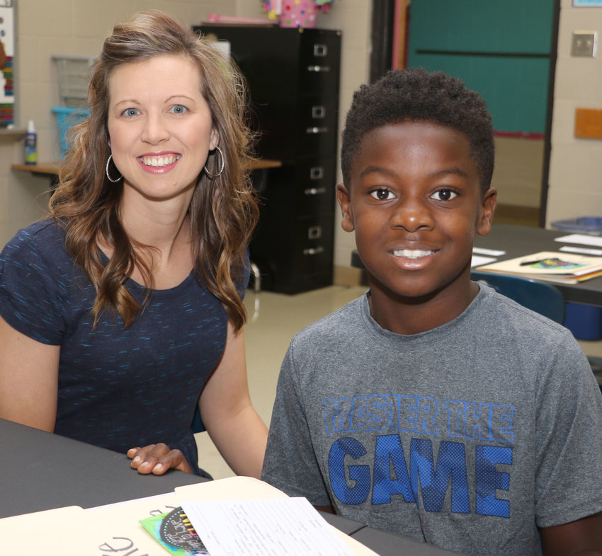 Pictured are Huntingdon third grade teacher Latasha Woodell welcomes one of her students, Duke McKinnie.
