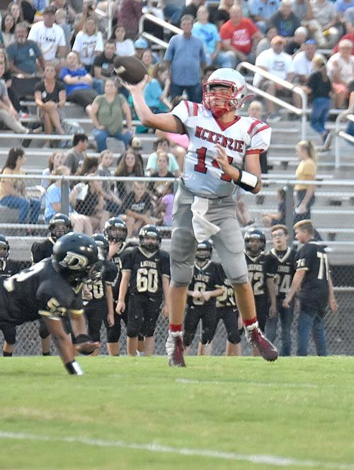 Rebel quarterback Tate Surber escapes a Lion defender and makes a game-tying touchdown throw.