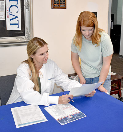 Kim Sanders (left), Chief Nursing Officer for Baptist Memorial Hospital of Carroll County, shares informative materials with Haylee Petty of Trimble, a second-year Pre-Nursing student at Bethel University.