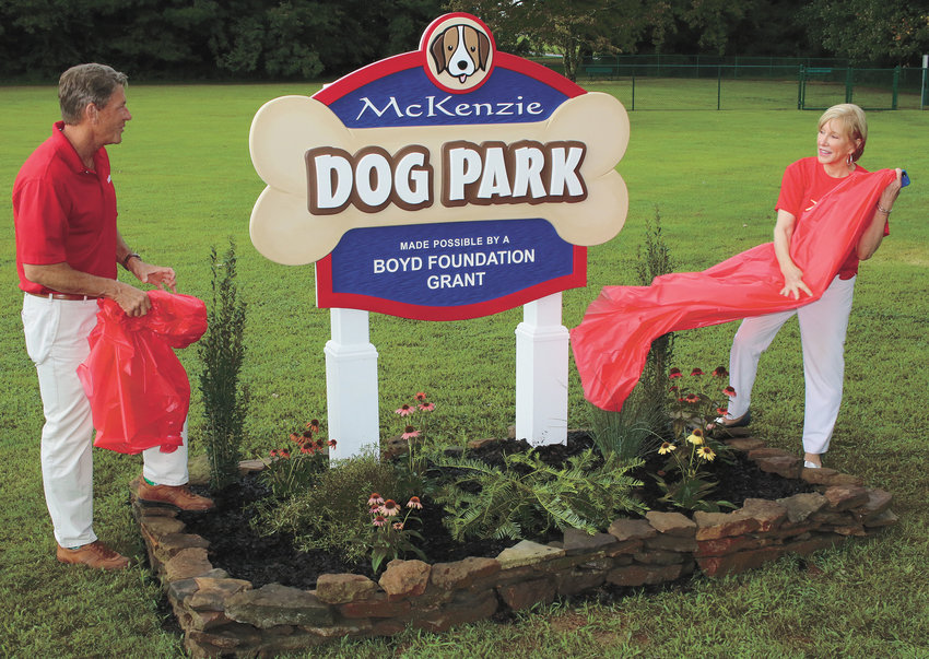 Randy Boyd and Mayor Jill Holland unveil the new sign, designed by Elliott's of McLemoresville. The dog park is free to use and is located adjacent to McKenzie City Park on Como Street.