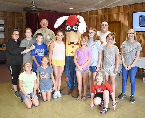 Kids paused from face-painting and other fun activities to meet Elroy the Elk. Pictured are (L to R): Kneeling — MaKayla Brinkley, Maleigha Nellett-Ray and Caydence Holifield; Standing — Stephanie Hollowell, Lodge Secretary Kassie Taylor, Chance Erikson, Past State President Hershel Wilkes, Raylene Stamm, Elroy the Elk, Bella Ritthaler, Brianna Yewell, Exalted Ruler Alan Martin, Chloe DeCanter and Tristyn Yewell.