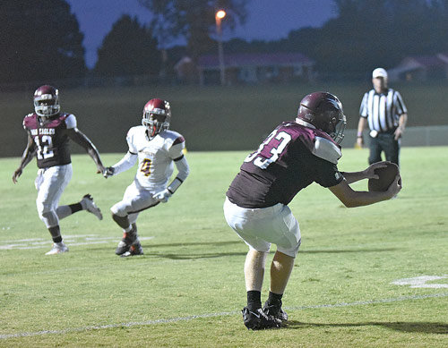 War Eagle Cody Wildridge snags a pass from Jeremiah Bryant (12) for a two-point conversion.