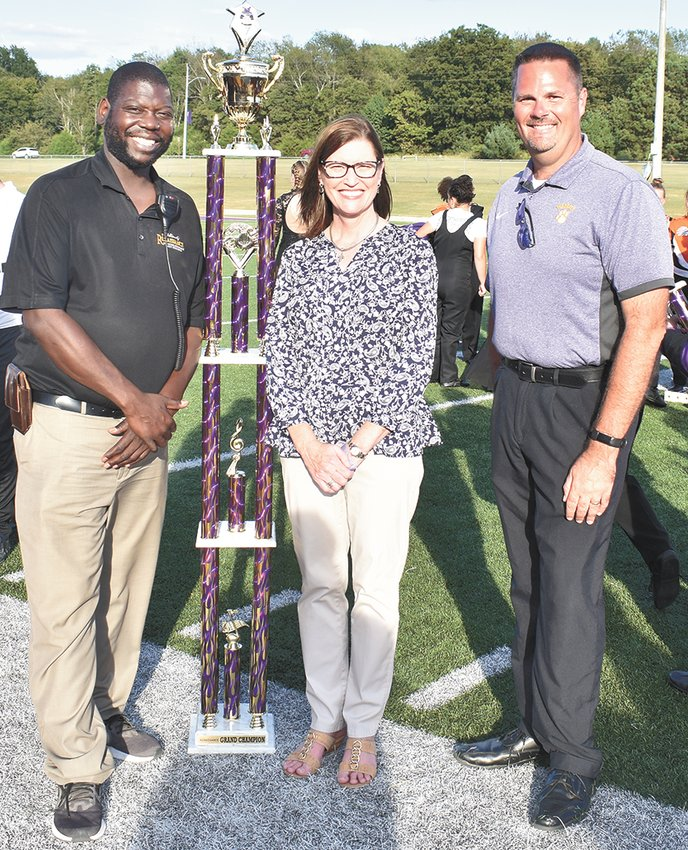 The Paragould (Arkansas) High School Marching Band was named Grand Champion. Pictured are (L to R): Tremayne Johnson, Director of Renaissance Percussion; Debbie Smith, Paragould School District Superintendent; and Keith Cottrill, Director or Renaissance Regiment.