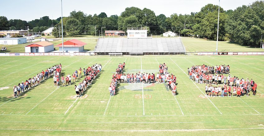 "McKenzie High School students created a giant ""MHS"" on the field at the end of the community pep rally."