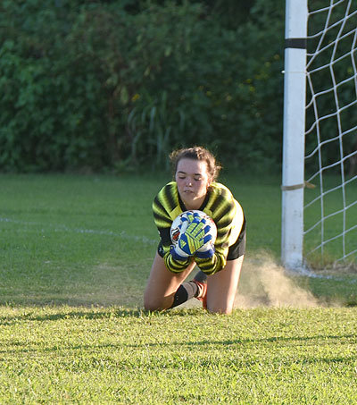 Lady Rebel goalkeeper Gracie Dillingham stops a Dyersburg shot for one of her ten saves in the win.