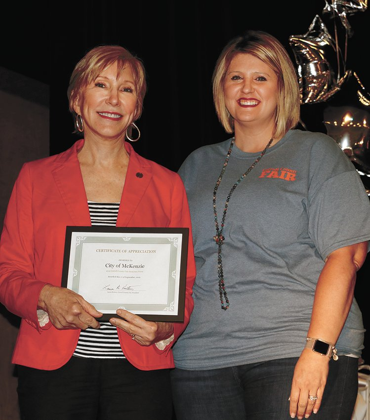 Pictured is Mayor Jill Holland accepting a certificate from Brittany Fowler, a member of the Fair Board.