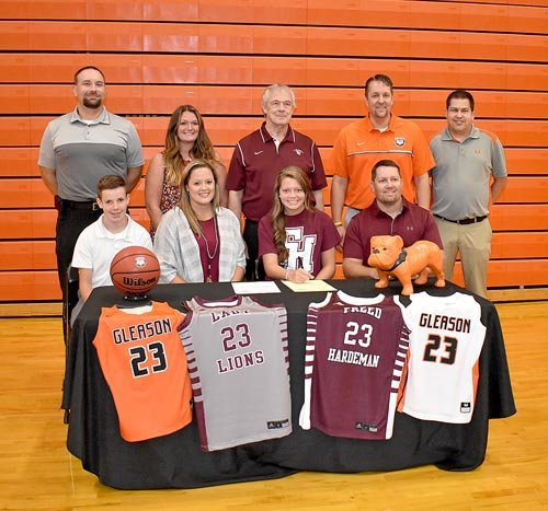 Gleason High School senior Kenady Atkins signs to play basketball for the Freed-Hardeman University Lady Lions. Pictured are (L to R): Seated — Baker Atkins (brother), Kara Atkins (mother), Kenady Atkins and Beau Atkins (father); Standing — Gleason Principal and Athletic Director Lee Lawrence, FHU Assistant Coach Brittany Cavender, FHU Head Coach Dale Neal, Gleason Head Coach Sean Stephenson and Gleason Assistant Coach Luke Hughes.