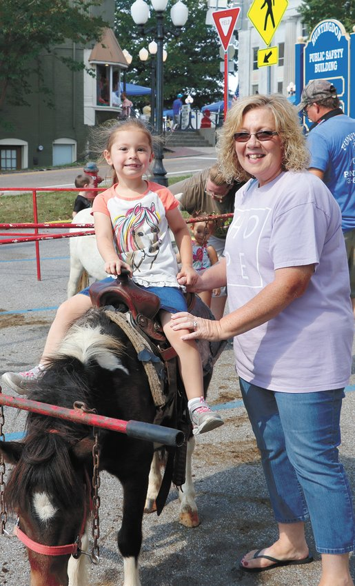 Paisyn Moore and grandmother Dee Walker with the ponies.