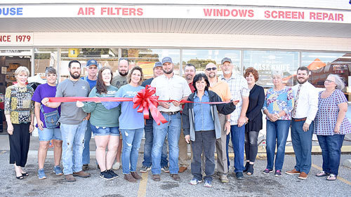 Owner Seth Bennett cuts the ribbon at Bennett Hardware, joined by employees, guests and community and business leaders, including McKenzie Mayor Jill Holland and Carroll County Mayor Joseph Butler.