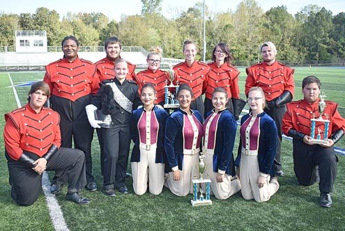 McKenzie Marching Rebel leaders display their preliminary trophies for second place band, percussion and color guard in Class AA. They also advanced to finals and earned sixth place band in Division I.