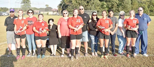 McKenzie High School Girls Soccer Seniors (L to R): Kim Essary with parents Jason and Kimberly Essary; Ellaina Moreno with mother Raelynn Moreno; Amber Wright with parents Kathy and Jeff Wright; Sabrina Renteria Vazquez with parents Virginia Vazquez and Manuel Renteria; and Isabella Colotta with parents Sharon and Terry Colotta.