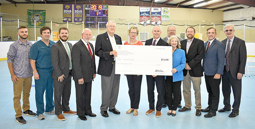 HUNTINGDON (October 8) — The Town of Huntingdon received a $13,000 Tourism Enhancement Grant Tuesday from the Tennessee Department of Economic and Community Development to be used at Bethel University's In-Line Hockey Rink for additional bleachers to add capacity and increase safety. Pictured are (L to R): Ryne Potts, BU In-Line Hockey Head Coach; Dr. Brock Martin; Carroll County Mayor Joseph Butler; State Representative Curtis Halford; Dale Kelley, Huntingdon Mayor and Bethel Director of Athletics; Marty Marbry, Department of Tourist Development; State Senator John Stevens; Jody Sliger, ECD Community Development Director; Carroll County Chamber of Commerce President Brad Hurley; Brad Chappell, Bethel Associate Athletics Director; Commissioner of Tourism Mark Ezell; and Bethel President Walter Butler.