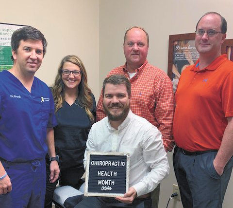 Pictured are Dr. Brock Martin and Dr. Krista Martin of Southern Chiropractic and Acupuncture in Huntingdon; Dr. Michael Roberts of Carroll County Chiropractic and Dr. Duane Patrick of McKenzie Family Chiropractic; and Carroll County Mayor Joseph Butler.