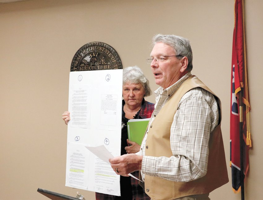 Cyril and Jan Ostiguy presented facts about the ongoing $10 wheel tax for the 1000-acre lake.