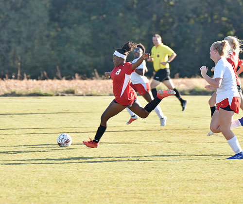 Lady Rebel Savannah Nesbitt gets in front of the Gibson County defenders for one of her three goals.