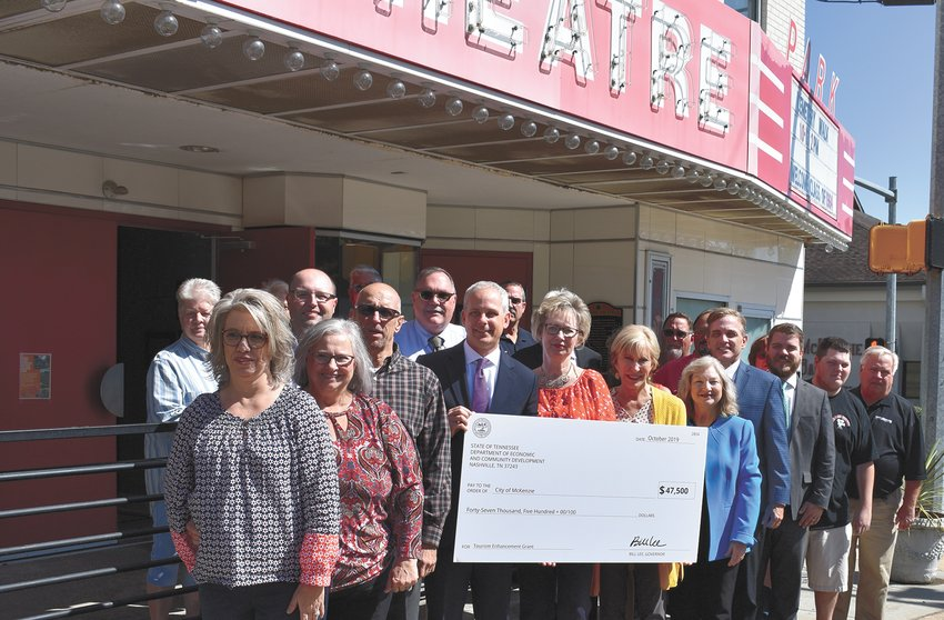 McKenzie (October 8) — Members of McKenzie City Council, Mayor Jill Holland, Sen. John Stevens, County Mayor Joseph Butler and several business owners were present for a check presentation from Tennessee Department of Tourism for $47,500 to be used to upgrade Park Theatre. The city-owned cinema in downtown McKenzie is renovated inside and needed its marquee updated.