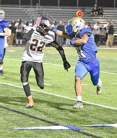 Mustang Malek Cannon stiff-arms Tiger defender Zyquavion Perry en route to a 33-yard touchdown.