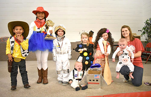 Family and group costume winners (L to R): First Place — Kingston and Kinsely Wilson; Second Place — Hayes, Lennon and Brooks Haywood; Third Place — Avery and Owen Winston.