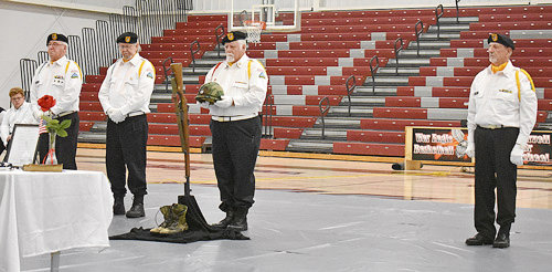 """Vietnam Veterans of America Chapter 995 performs the """"Soldier's Cross"""" ceremony."""
