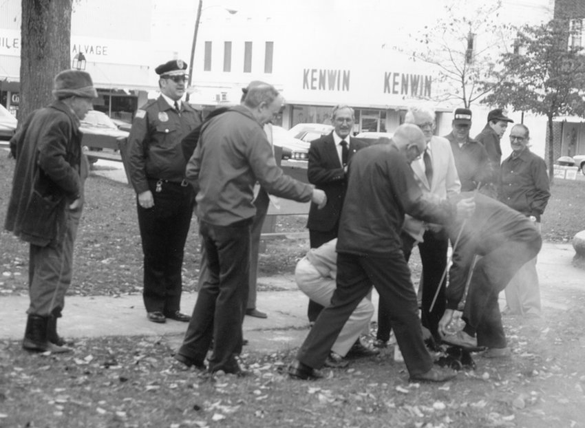 Gathering to fire the cannon in honor of Veterans Day, early 1980s, were: Vester Washburn, Chief Raymond McDade, Bailey M. Wrinkle, Wilburn Headden, Cecil Purvis, Dale King, Franklin Howell, Gaylon Hickman, David Hickman and Barney Forbes.