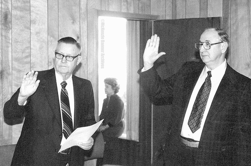 "City Attorney Ralph Stobbe administers the Oath of Office to Mayor H.B. ""Swat"" Scarbrough, 1980."