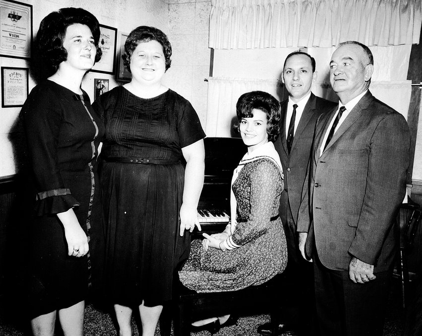 The Happy Five Quartet gospel group performed on W.H.D.M.'s live Sunday morning broadcast from 1960 to 1994. (L to R); Donna Garner Bates, Gay Castleman Purvis, Leon Purvis, Lewis Garner. Seated at  piano, Nancy Hicks Crow.