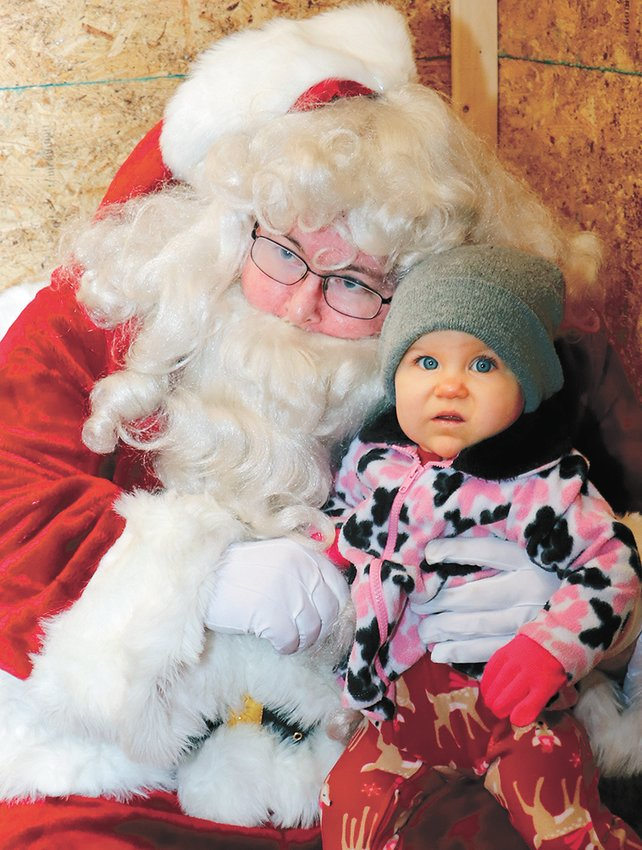 Lilly Carson, 9 months old, visits with Santa at Gleason.