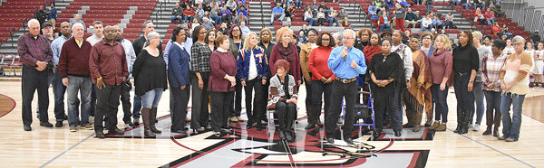 The family of Coach Richard Welch are joined by dozens of former players, including many from his two state championship teams.