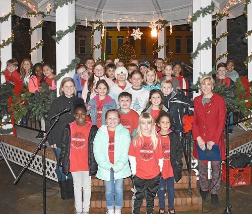 "McKenzie Elementary's Rebel Singers, directed by Joanna Turner (left) once again opened McKenzie's Mistletoe Christmas. They performed ""Holly Jolly Christmas,"" ""Let it Snow, Let is Snow, Let is Snow,"" ""Over the River and Through the Wood,"" ""I want to be an Elf,"" and ""O Christmas Tree."" Mayor Jill Holland (right) presented the group with an official proclamation in appreciation of their efforts."