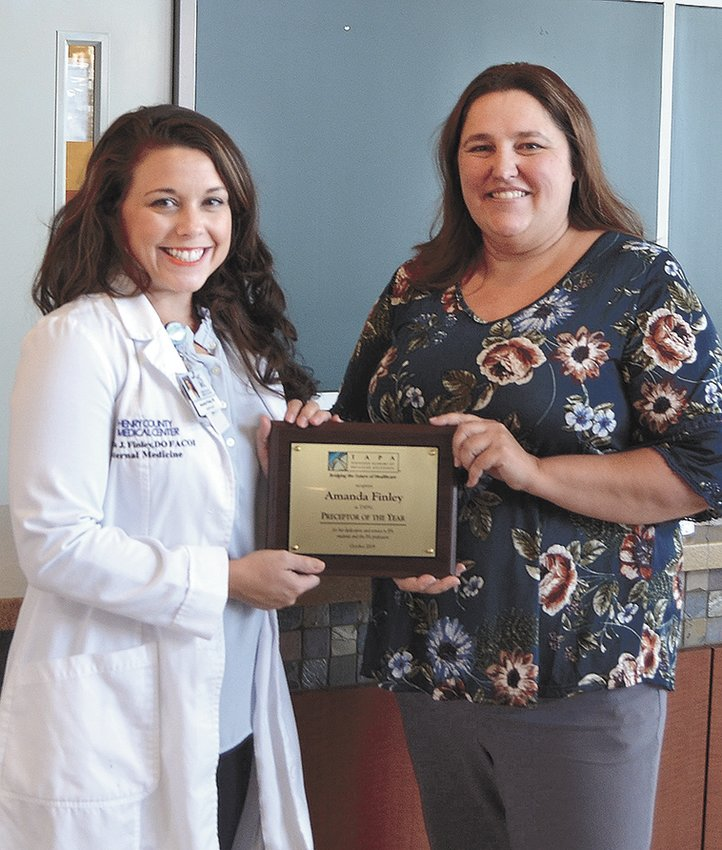 Pictured is Amanda Finley, DO FACOI, FACP, hospitalist for Henry County Medical Center being presented with the Preceptor of the Year Award. Dr. Finley practices in the Hospitalist Program at HCMC and serves as the director of Medical Education and Student Affairs.